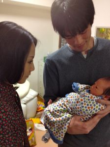 Lisa with her brother and his newborn son Hiroto.
