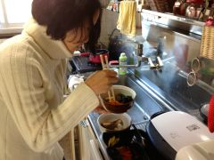 Lisa busy cooking our New Year's osechi. She cooked for two days straight. I helped.