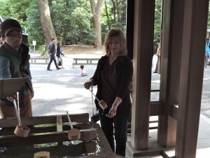 Mom rinses her hands in 'holy' water before entering Meiji Jingu Shrine.
