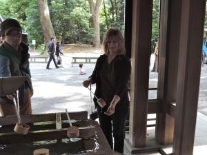 Mom rinses her hands in 'holy' water before entering Meiji Jingu Shrine.