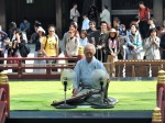 Some old dude plays some sort of old 'guitar' type instrument in Meiji Jingu.