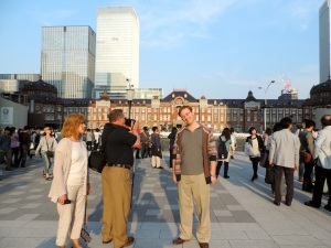 A natural family pose in front of Tokyo Station.