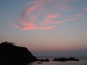 Sunset over Oura Beach.