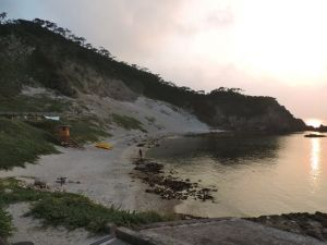 Sunset over Oura Beach. Our tent is just up the hill from the lifeguard tower.