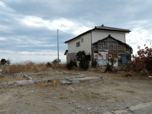A house somehow still standing in Iwate.