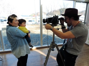 Brian taking Kaori's picture with her son.